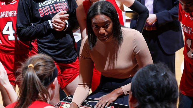 Gardner-Webb women's basketball coach Alex Simmons chats with her team during a huddle last season.