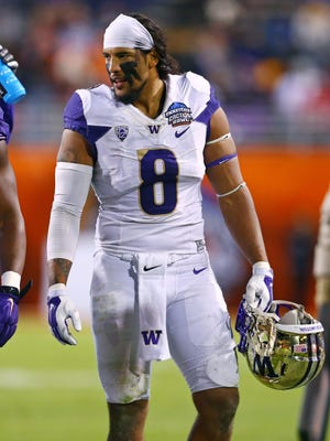 Washington linebacker Hau'oli Kikaha was selected in the second round of the NFL Draft by the New Orleans Saints.