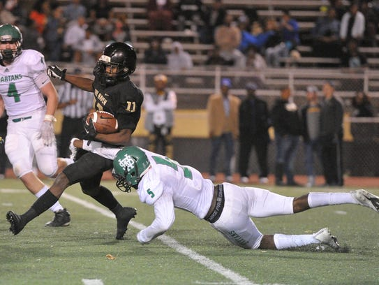 Whitehaven running back Cameron Sneed (11) carries
