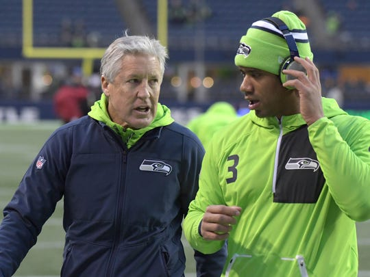Seattle Seahawks coach Pete Carroll talks to quarterback Russell Wilson prior to their game Los Angeles Rams at CenturyLink Field.