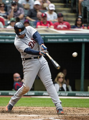 Miguel Cabrera hits a single off Trevor Bauer during the third inning Sunday in Cleveland.