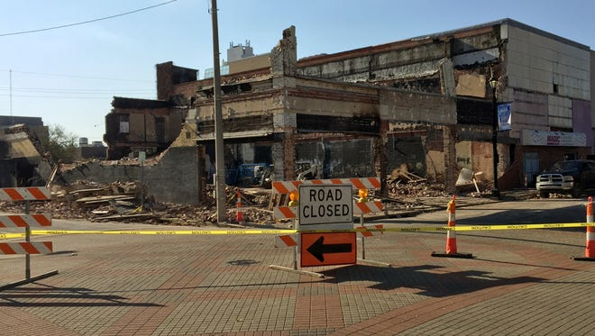 The Skye building at the corner of 3rd and Washington streets was being demolished Friday.