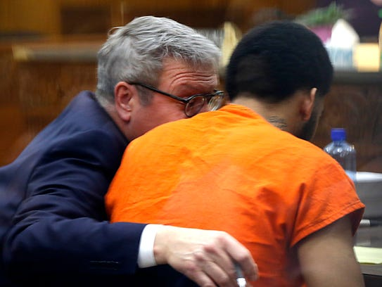 Dominique Heaggan-Brown (right) speaks with his attorney