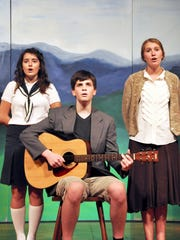 """Jadon Schrawder, as Captain von Trapp, Athena Kelly as Maria, and Faith Hundley as Liesl, rehearse a scene from """"The Sound of Music."""" The CFABS youth production runs Aug. 19-21 at the Center for Performing Arts Bonita Springs."""