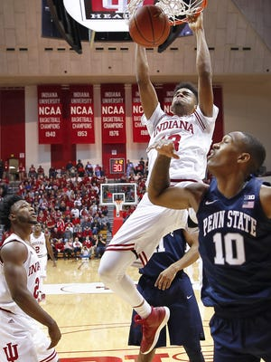 Indiana Hoosiers forward Juwan Morgan (13) dunks the ball as Penn State Nittany Lions guard Tony Carr (10) looks on at Simon Skjodt Assembly Hall in Bloomington, Ind., on Wednesday, Jan. 9, 2018.