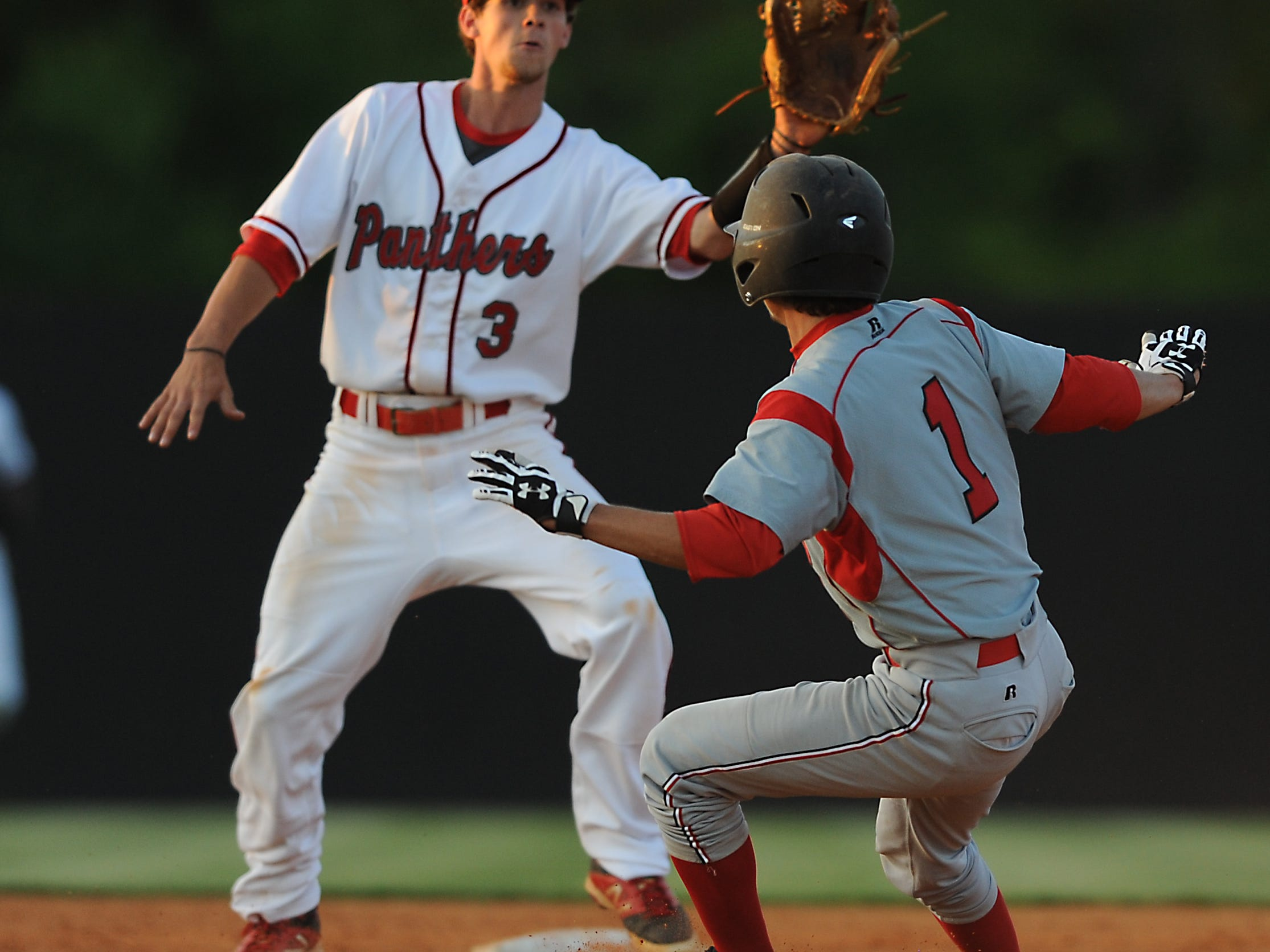 Petal shortstop Zach Giacona fields the ball as Harrison Central's Austin Johnson puts on the brakes in Thursday's game at Panther Field in Petal.