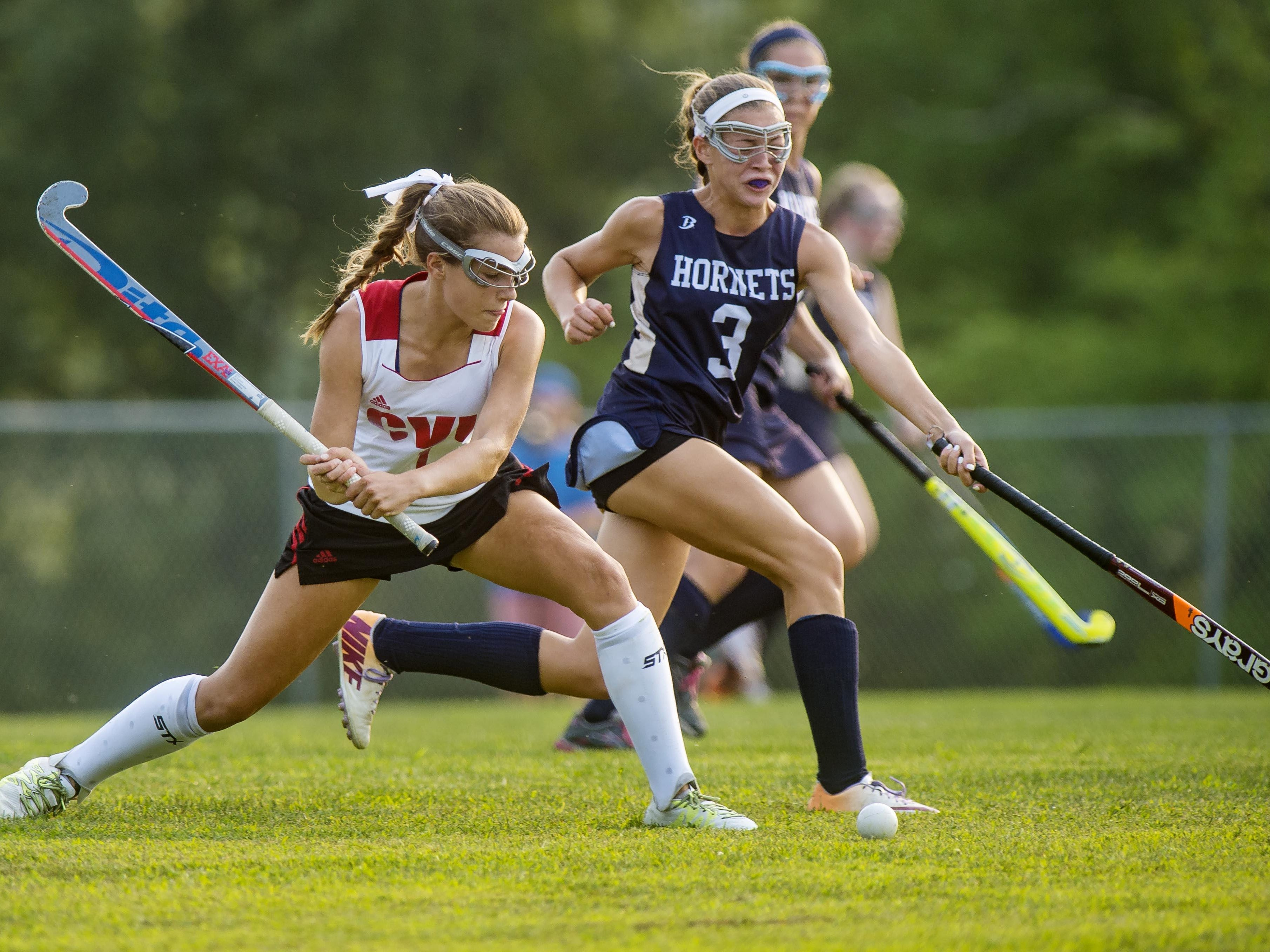 CVU's Lydia Maitland, left, shoots in front of Essex's Jenna Puleo in Hinesburg earlier this season.