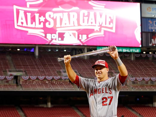 Mike Trout poses with the MVP trophy after the All