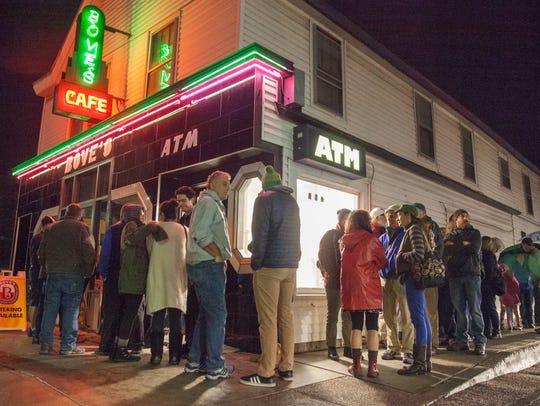 A line of patrons wraps around Bove's Restaurant Tuesday