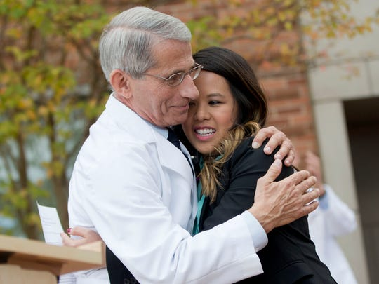 In this 2014 photo, Nina Pham is hugged by Dr. Anthony Fauci, Director of the National Institute of Allergy and Infectious Diseases, outside of National Institutes of Health in Bethesda, Maryland. Pham, the first nurse diagnosed with Ebola after treating an infected man at a Dallas hospital, is free of the virus, and Fauci hugged her as a way of showing others that those recovering should not be stigmatized.
