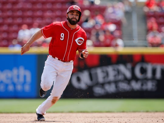 Cincinnati Reds second baseman Jose Peraza (9) runs for third base on a Joey Votto single in the bottom of the sixth inning of the MLB National League game between the Cincinnati Reds and the New York Mets at Great American Ball Park in downtown Cincinnati on Wednesday, May 9, 2018. The Reds won 2-1 on a 10th inning walk off home run by Adam Duvall.