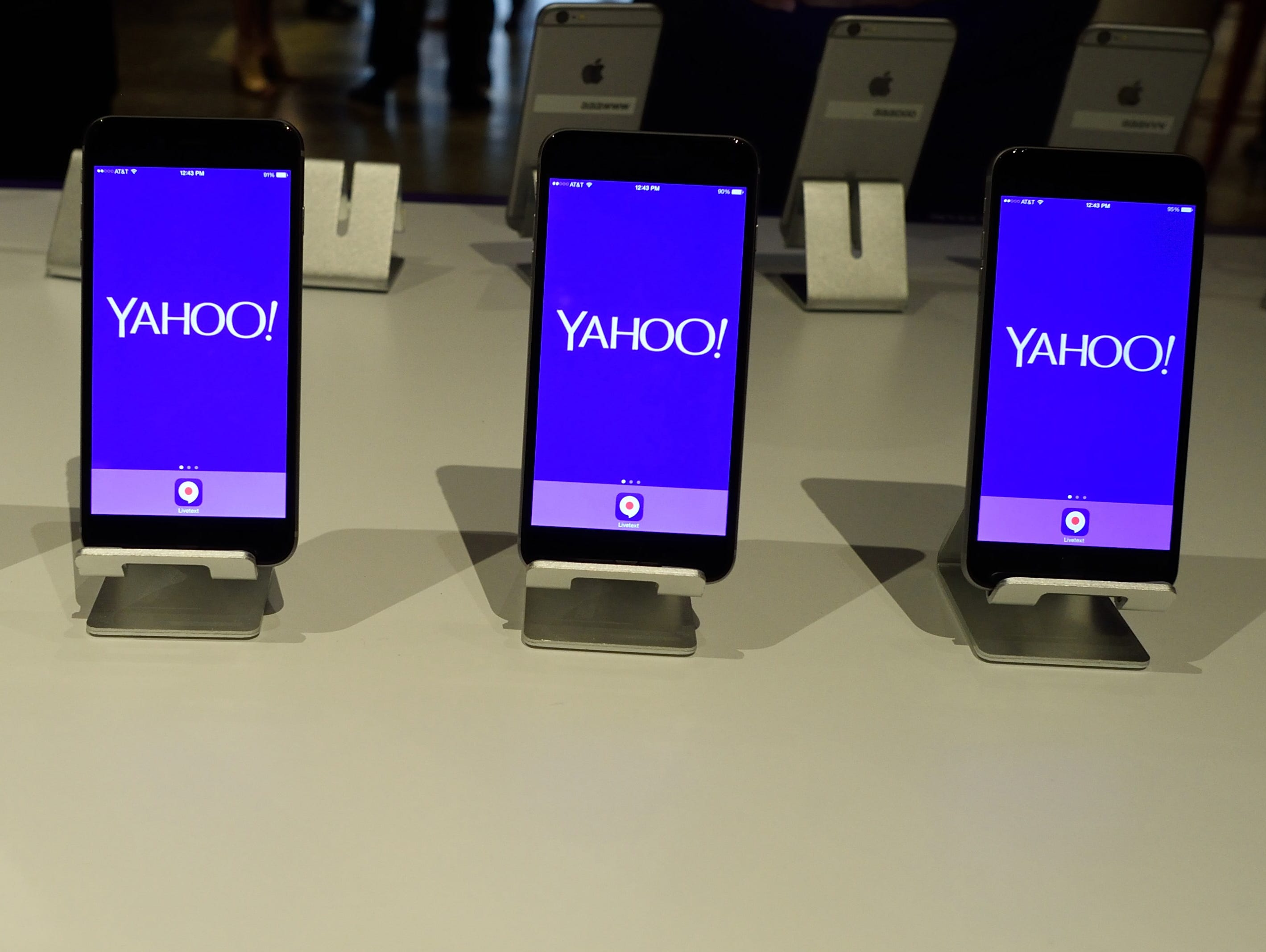 Phones set up to demonstrate Livetext are seen during a Yahoo news conference July 29, 2015 in New York.