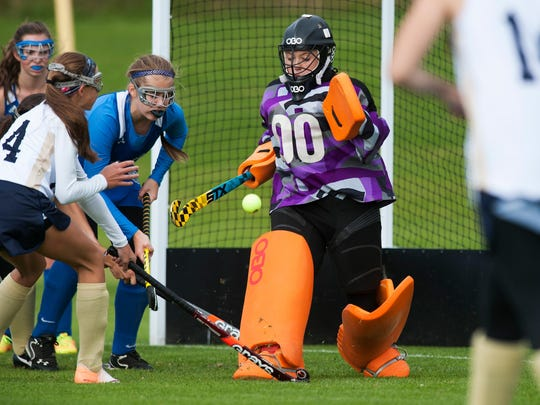 Colchester goalie Abby Ladd (00) makes a save during the varsity field hockey game between the Colchester Lakers and the Essex Hornets last season.