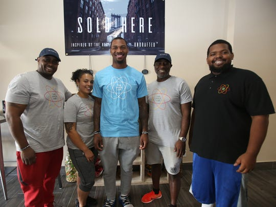 Brooklyn Nets star Sean Kilpatrick, center, is photographed with his staff at his new juice and smoothie bar in White Plains called The Juice Lab Aug. 17, 2017.