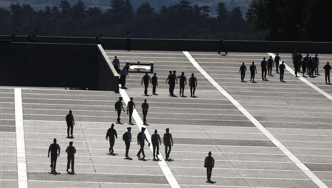 Brennan Linsley/AP In this Aug. 13, 2014 file photo, cadets walk between classes on the Air Force Academy campus, near Colorado Springs. FILE - In this Aug. 13, 2014, file photo, cadets walk between classes on the Air Force Academy campus, near Colorado Springs, Colo. Reports of sexual assaults at the three military academies surged by more than 50 percent in the 2014-15 school year, and complaints of sexual harassment also spiked, according to Pentagon officials. (AP Photo/Brennan Linsley, File)
