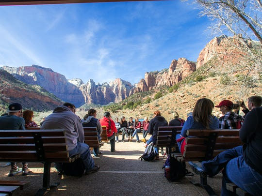 Students participate in a lecture inside Zion National
