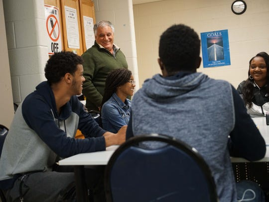Left to right: Students Dhamiere Moody, 21, Daniel Pryor, 18, Mercedes Badson, 16, and Latika Rice, 20, get a surprise visit from Paul Calistro, executive director of the West End Neighborhood House.