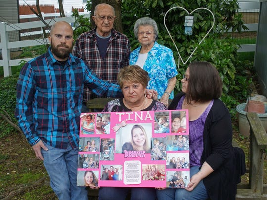 Linda Bucci holds a poster with pictures of her daughter Tina, who died of an overdose in November 2015. Her son Bruce and daughter Megan Werkheiser sit next to her while her parents, Tina and Nicholas Bucci, stand behind her.