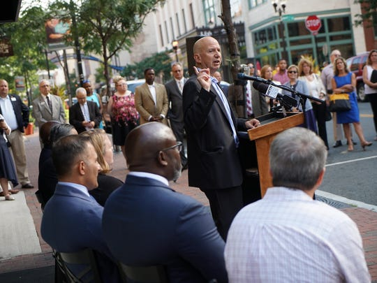 Gov. Jack Markell speaks at a First State Community Loan Fund press conference on Wednesday to announce a new loan program for small businesses along Market Street.