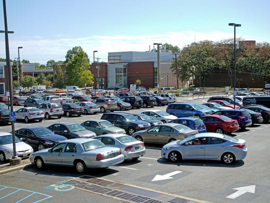 Motorists navigate a parking lot between Main Street