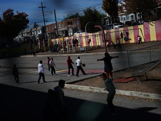 Students play at Pulaski Elementary in Wilmington on