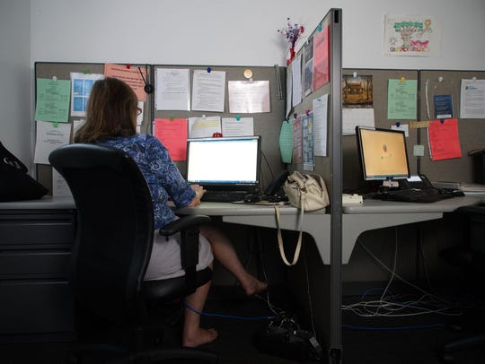 A crisis hotline operator waits for calls at Contact Lifeline, a non-profit agency that handles calls from people with suicidal thoughts and victims of sexual assault.