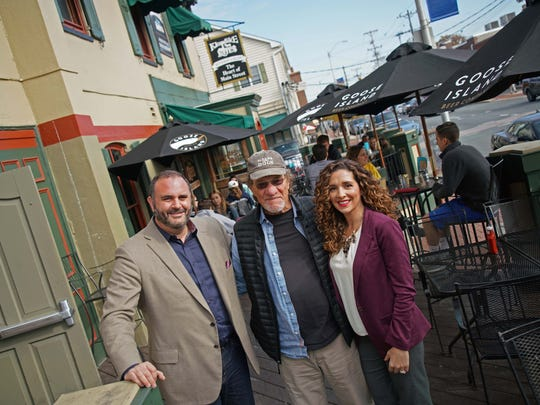 Alan Burkhard (center) has sold Klondike Kate's to Gianmarco Martuscellli and wife Gilda, who also own the Chesapeake Inn in Chesapeake City, Md., and La Casa Pasta in Glasgow.