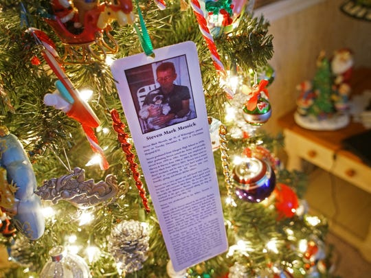 A memorial with the picture of Steven Messick hangs on Harry Christensen and Barbara Hurley's Christmas tree. Messick, Hurley's son, died before Christmas of last year.