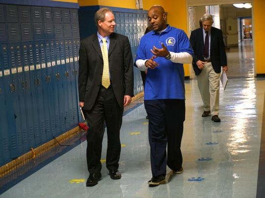 """Candidate for superintendent for the Christina School District Gerald (Jerry) B. Wilson walks with Harold """"Butch"""" Ingram, principal of Bancroft Elementary School while taking a tour of the school."""