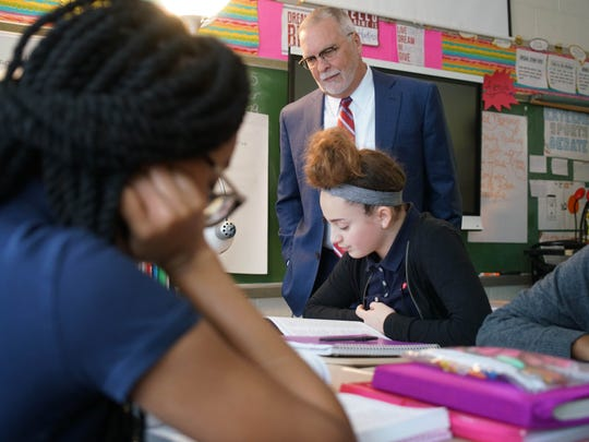 Candidate for Christina School District superintendent, Richard L. Gregg, looks over the shoulder of 13-year-old Autumn Durante, an eighth-grader at Kirk Middle School, while touring the school.