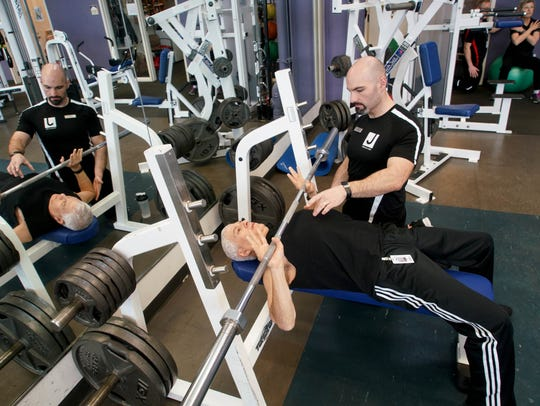 Jeffrey Rubin lifts weights with his trainer Chris
