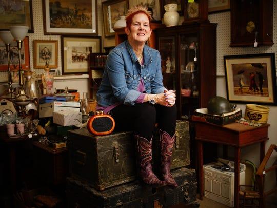 Lisa Hill wears black leggings from Genie.com; purple sweater from J Jill; her mom's 1960s denim jacket; purple cowboy boots from Sheplers Western Wear