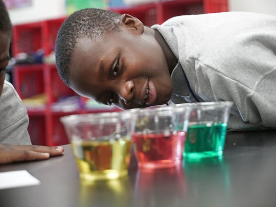 Ten-year-old Romere Kellum (left) and his classmate, 10-year-old Prince Oppong, both fifth graders at Charter School of New Castle, work together on a science experiment in class. The school engages kids of all ages in conversations about their futures.