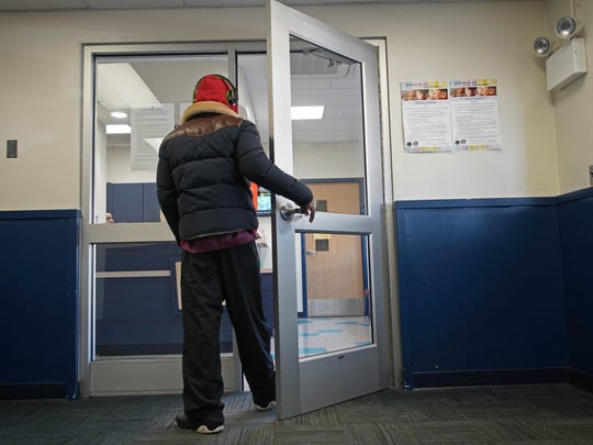 A visitor to Shortlidge Elementary School enters a secured reception area before being permitted to enter the main part to the school.