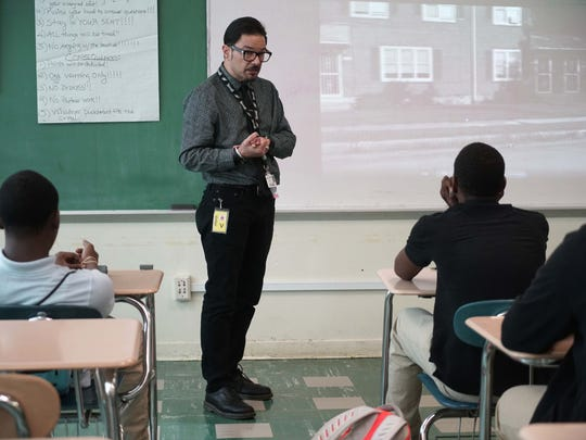 Chaz Molins, a Christiana Care clinical social worker for the Violence Outreach, Intervention and Community Engagement program, gives a presentation to students at Dickinson High School.