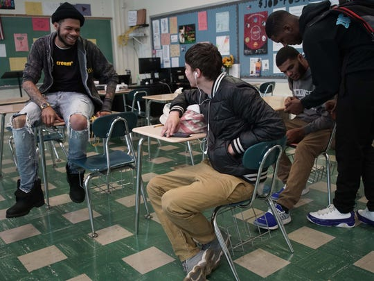 Christian Harris, who was shot four times in 2015, speaks with Dickinson High School senior Norberto Rivera while visiting the school to teach about the dangers of gun violence.