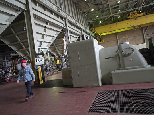 A worker walks through the turbine floor at the McKee
