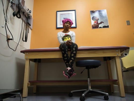 Trinity waits in a room to see her pediatric endocrinologist Dr. Daniel A. Doyle at Nemours/Alfred I. duPont Hospital for Children for a routine check of her development though puberty.