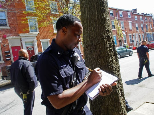 Capt. Demetrius Todd with the Wilmington Fire Department makes notations of safety issues with vacant properties on the 500 block of W. Seventh St.