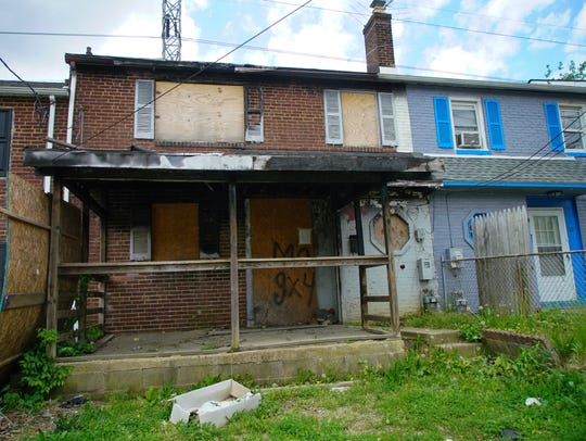 A vacant home sits in the first block of S. Rodney
