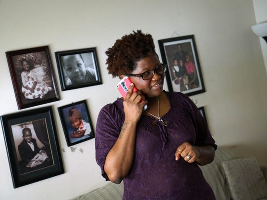 DeShanna Neal talks on the phone in her home.