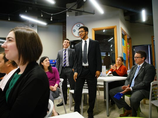 Keith Doggett and Jordan Gonzalez stand up Tuesday during a press conference at the University of Delaware's Horn Program in Entrepreneurship office to announce the startups new deal with the Delaware Tourism Office and Division of Parks and Recreation.