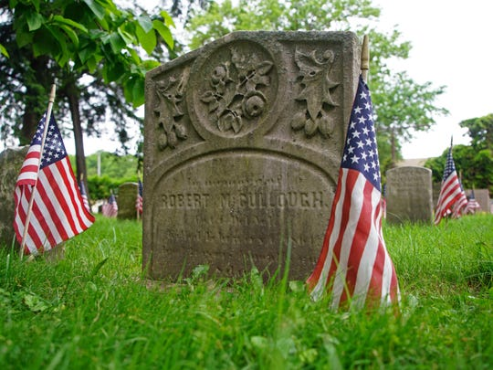 A headstone marks the resting place of a Civil War veteran in the Wilmington and Brandywine Cemetery in Wilmington. Brandywine Hundred resident Finlayson spent some 600 hours writing biographies for each of the Civil War veterans buried in the cemetery.