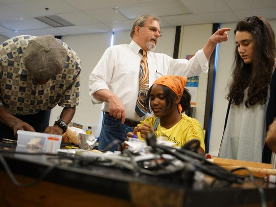 """Charles Halfen, an engineering teacher at Newark High School, oversees his Engineering II class held in the """"make space."""" In a recent survey by the Rodel Teacher Council, educators say they lack guidance on how to implement social and emotional learning."""