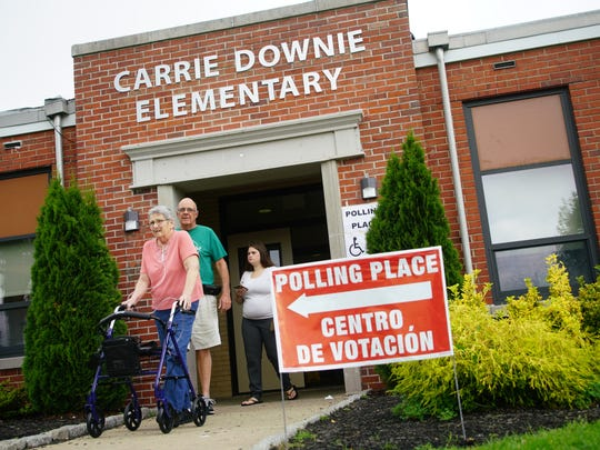 Alicia and Chet Riches leave Carrie Downie Elementary School after voting for the Colonial School District Referendum.