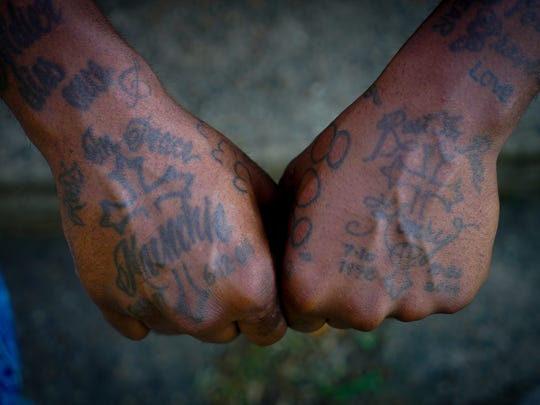 North Carolina state law says gangs are criminally oriented groups that share identifying characteristics such as tattoos.