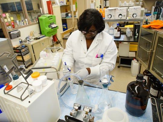 Nikia Green, a lab technician for the Delaware Health and Social Services Public Health Lab works in the Environmental Chemistry lab.