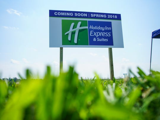 Rishen Patel, who owns Manhattan Bagel in Middletown, has broken ground on building a Holiday Inn Express & Suites hotel behind GrottoÕs Pizza on Auto Park Drive.