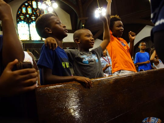 (left to right)Nasir Samuels, 10, Kingston Dixon, 7,  and Jaydn Jenkins, dance to positive songs at the beginning of their day at Freedom School held in the Mother African Union Church.