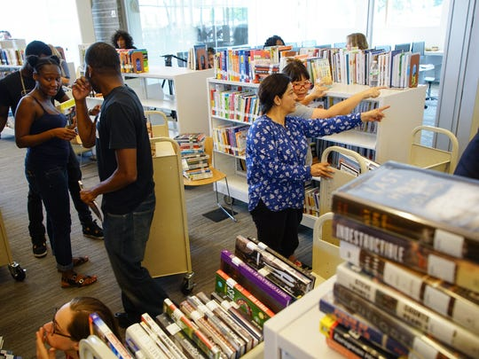Volunteers sort and put books on shelves at the Route 9 Libary.